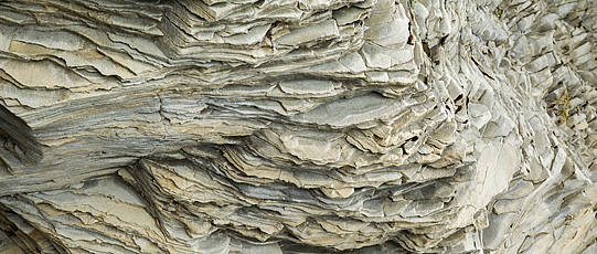 Rock with conchoidal fracture.
